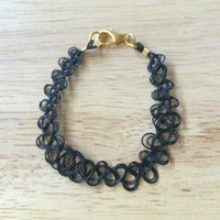 Tattoo Bracelet with clasp (double strand - black or clear)