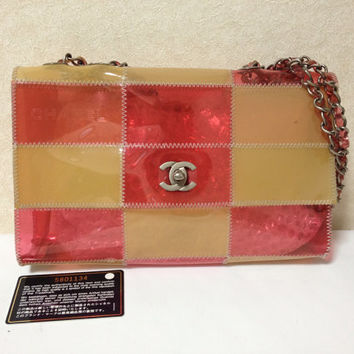 Vintage CHANEL pink and yellow clear vinyl 2.55 chain shoulder bag.