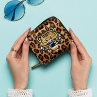 Skinnydip Leopard Print Zip Around Purse With Tiger Applique at asos.com