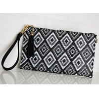 Becoming Audrey Black & White Woven Clutch