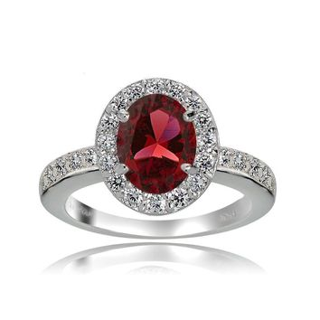 Sterling Silver Created Ruby and White Topaz Oval Halo Ring