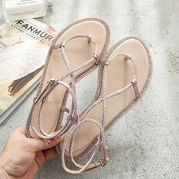 Fashion diamond sandals women's new snake-shaped twisted flat-soled diamond sandals cross-strap shoes