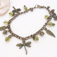 Rainforest -  bronze bracelet with dragonfly and peridot green beads