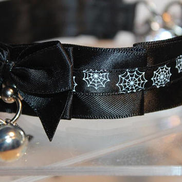 Premade thin kittenplay petplay Halloween collar with black base, spider web print and small jingle bell