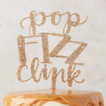 Alexis Mattox Design New Year's Cake Topper in Gold Size: One Size Gifts