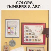 Colors, Numbers, & ABCs counted cross stitch booklet for children's samplers by Patricia Gaskin counting vintage train, primary colors