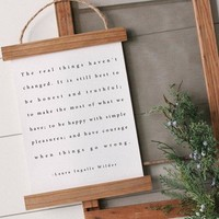 """The real things haven't changed"" Laura Ingalls Wilder Quote Hanging Canvas Poster"
