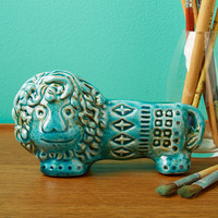 Lion Paperweight, Set of 4 design by Twos Company