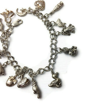1950s sterling silver charm bracelet with 14 charms, Coca Cola, animals, hearts