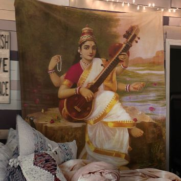 The Hindu god Saraswati with her Sitar and Peacock - Tapestry