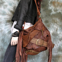 Distressed rusted brown leather bag studded fringed hobo fringe artistan purse bohemian african jungle distressed raw festival free people