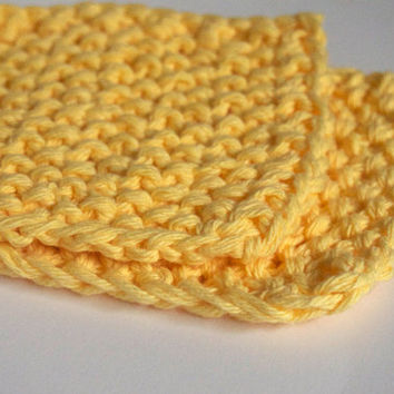 hand knit plushy small washcloth in canary yellow