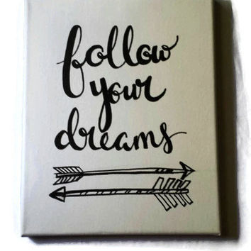 Hand Lettered Canvas Quote Wall Hanging Follow Your Dreams Hand drawn Arrows Wall Decor Painting Customizable with various sizes and colors.