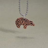 Spirit bear copper necklace with swirling and hammered texture