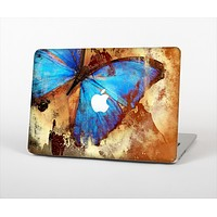 """The Bright Blue Butterfly on Grunge Gold Surface Skin Set for the Apple MacBook Pro 13"""" with Retina Display"""