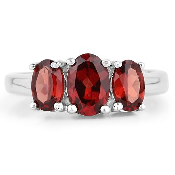 A Special Edition Natural Oval Cut Red Garnet Journey Ring