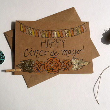 Happy Cinco de Mayo Celebration Card- Handwritten on Kraft Brown with Tassel Banner and Floral Illustration