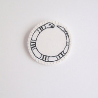 Embroidered snake brooch black and white on cream muslin with cotton wool felt backing Winter fashion An Astrid Endeavor ouroboros
