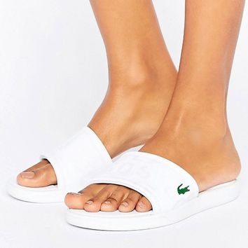 Lacoste Sliders In White With Croc Logo at asos.com