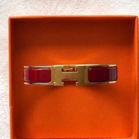 Authentic Hermes red H bracelet in original box.