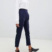 ASOS DESIGN tapered trousers in nightwatch check with contrast panel at asos.com
