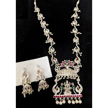 Silver matte rhodium plated Goddess Lakshmi pendant with peacock charm long chain necklace and jhumka earring set