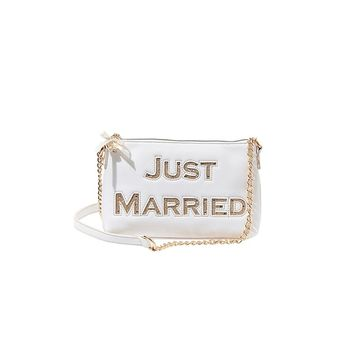 Proclaim your new marital status with the help of Betsey Johnson's Just Married Shoulder Bag. This bag is made of a luxe faux leather that allows for both long use and a chic touch to your outfit. The golden chain also brings out the glittering golden deta