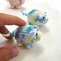 Blueish piggy knitted baby toy, little pigs stuffed toy white with blue, yellow and green spots