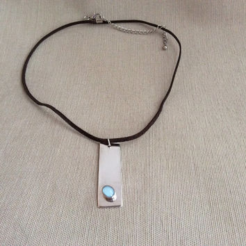 Sterling Silver Tag Pendant With Blue Cabochon Stone