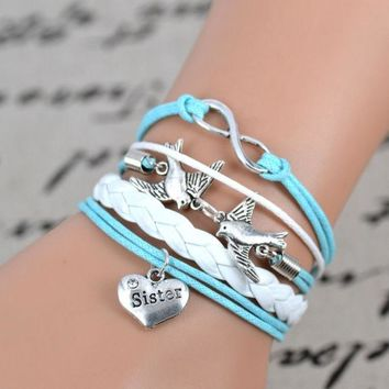 DCCKIX3 silver tone Peace Dove infinity charm bracelet,sister charm ,light blue white leather bracelet. = 1932519492