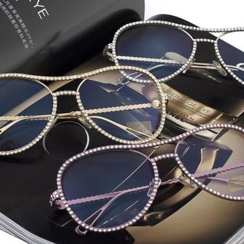 Blinged out aviator sunglasses