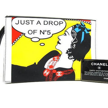 So lovely CHANEL pre-loved patent enamel clutch purse in rare print, Just a drop of Number 5, Chanel figure in black, yellow, and red.