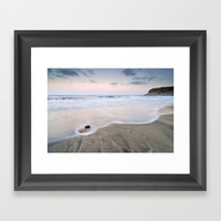 Pink sunset at the volvanic sea Framed Art Print by Guido Montañés