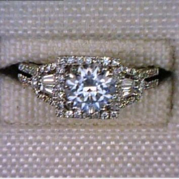 Lady's 14 Karat White Gold Contemporary Engagement Ring with Round Diamond