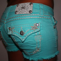 turquoise miss me shorts size 25!