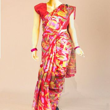 the muralistic tussar silk saree fully patterned with salsa red base