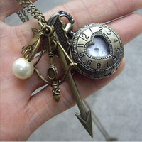 The Hunger Games Inspired Arrow,bow, Mockingjay and Peeta Pearl Heart Roman numerals Pocket watch Locket Necklace