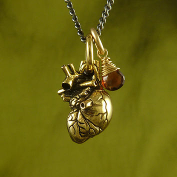 "Gold Anatomical Heart and Garnet Necklace - Small 24 Karat Gold Plated Anatomical Heart Pendant with Garnet on 24"" Gunmetal Chain"