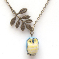 Antiqued Brass Leaf Porcelain Owl Necklace by gemandmetal on Etsy