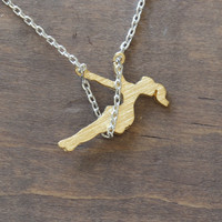 dainty girl on swing set necklace