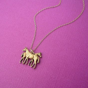 the horse twins necklace in gold gift for her gemini