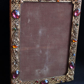 Incredible antique French brass jeweled filigree gilt picture frame with fleurs-de-lis, amethysts and multi-colored rhinestones.