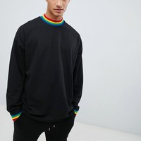 ASOS DESIGN oversized longline long sleeve t-shirt with rainbow neck and cuff in black at asos.com