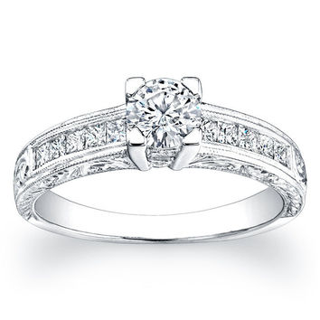 Ladies Platinum antique engagement ring with 0.33 ctw of G-VS2 princess diamonds channel-set