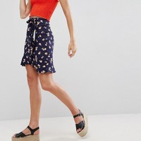 ASOS Wrap Mini Skirt with Tie Waist in Floral Print at asos.com
