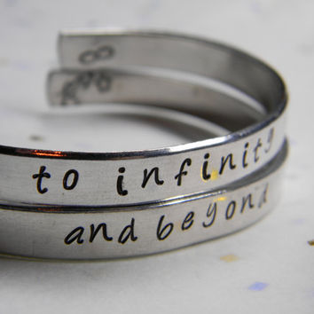 to infinity and beyond two aluminum bracelet 1/4 inch wide