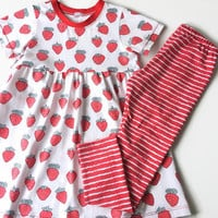 Girls dress with short sleeves. Summer dress. White jersey fabric with red strawberries. Toddler dress, skater dress