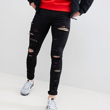 Jaded London Muscle Fit Jeans With All Over Rips In Black at asos.com