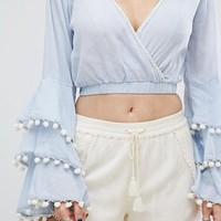 Glamorous Wrap Front Crop Top With Tiered Pom Pom Trim Sleeves at asos.com