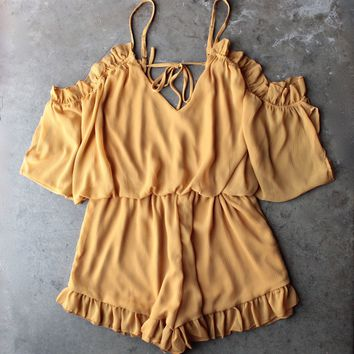 chiffon peek a boo shoulder romper with ruffle hem in mustard